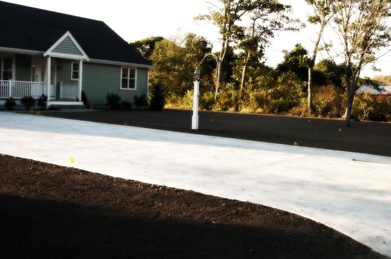 Cape Cod Landscape & Hydroseeding, Lawn Preparation, Loam Delivered and spread for new lawn